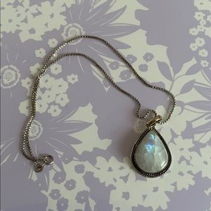 Silver necklace with teardrop opalescent stone